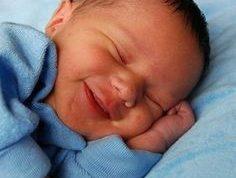 منشا خنده نوزاد در هنگام خواب