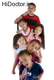 آموزش مسواک و نخ دندان از کودکی