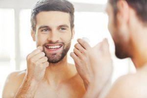 آموزش نخ دندان کشیدن